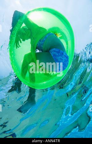 Underwater shot of child in inner tube, Florida, United States - Stock Photo