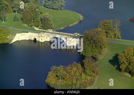 Aerial view of the Grand Bridge at Blenheim Palace spanning the lake near Woodstock in Oxfordshire - Stock Photo