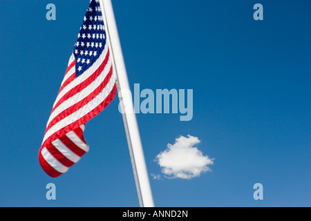 Stars and Stripes us flag against blue sky - Stock Photo