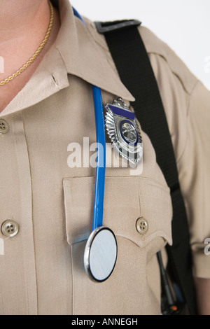 View of a Emergency Medical Service officer wearing a stethoscope. - Stock Photo
