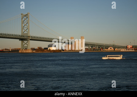 Duck tours amphibious landing craft in Delaware river with Benjamin Franklin Bridge Philadelphia Pennsylvania  November - Stock Photo