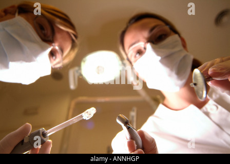 Dentist at work, seen from patient's point of view - Stock Photo