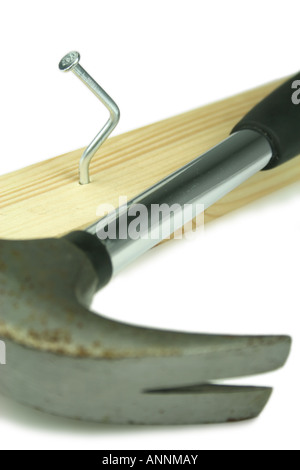 bent nail hammered into wooden batten - Stock Photo