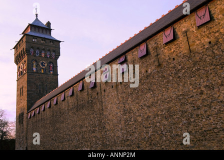 Horizontal wide angle of Cardiff's iconic landmark, the Clock Tower and high wall surrounding Cardiff Castle [Castell - Stock Photo