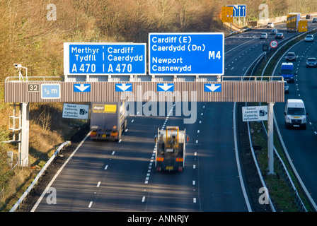 Horizontal view of lots of traffic speeding along the M4 motorway towards Cardiff on a bright sunny day - Stock Photo