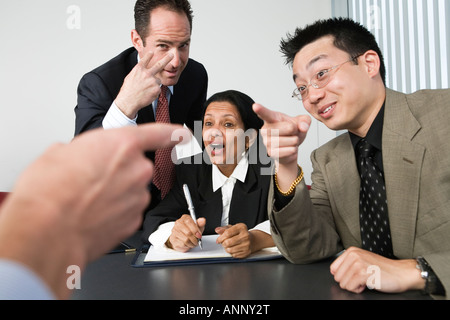 View of businesspeople blaming each other in an office. - Stock Photo