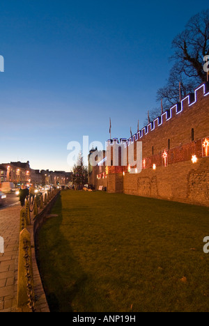 Vertical wide angle of Cardiff Castle [Castell Caerdydd] illuminated with Christmas lights at night - Stock Photo