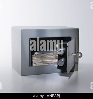 savings cash in home safe or bank under lock and key - Stock Photo
