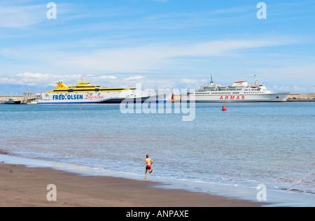 Canary Island ferry boats in the harbour of San Sebastian seen from Playa de San Sebastian, La Gomera - Stock Photo