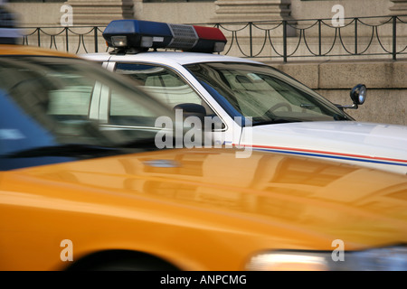 New York taxi and Postal Police car - Stock Photo