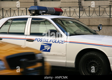 US Postal Police and New York Taxi - Stock Photo