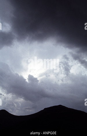 Scene of dramatic storm clouds over a mountain Abstract Concepts Backgrounds Book covers violent turbulent weather - Stock Photo