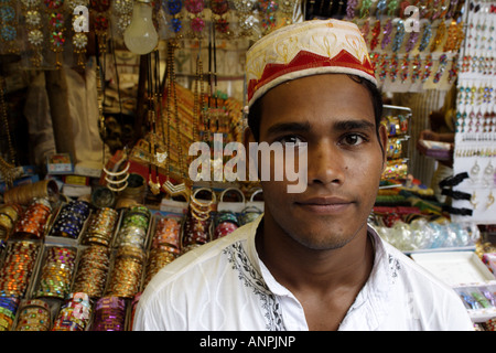 A trader stands in front of his bangle stall in Kolkata, India. - Stock Photo