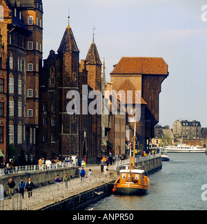 GDANSK CRANE GATE Old town buildings and crane gate on the banks of the River Motlawa Gdansk Poland - Stock Photo