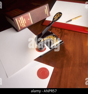 Corporate seal press for official important legal and business company documents - Stock Photo