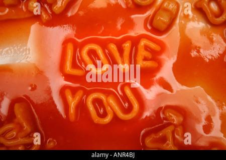 LOVE YOU written in Alphabetti spaghetti - Stock Photo