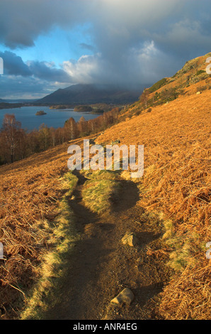 Eroded footpath on the fell side above Derwent Water in the Lake District. - Stock Photo