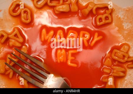 MARRY ME written in Alphabetti spaghetti - Stock Photo
