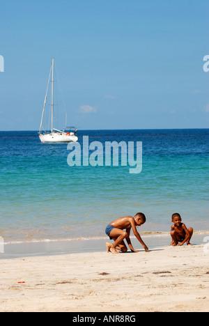 Two children on the beach, Punta Popy, Dominican Republic, Caribbean - Stock Photo