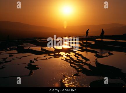 Sunset over the Travertine pools Pamukkale - Stock Photo