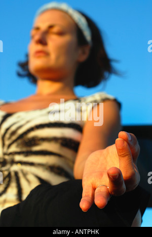 A woman sitting in the lotus position - Stock Photo