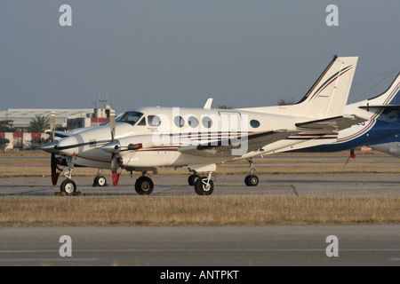 Beech C90B King Air turboprop commuter plane parked at airport apron - Stock Photo