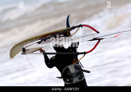 windsurfers on the isle of wight in rough seas at Compton and gurnard - Stock Photo