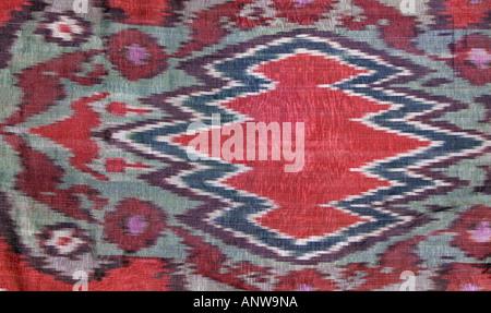 Ikat patterned silk fabric from Uzbekistan Detail of Uzbek silk coat Central Asia - Stock Photo
