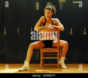 Multi ethnic woman in gym locker room - Stock Photo