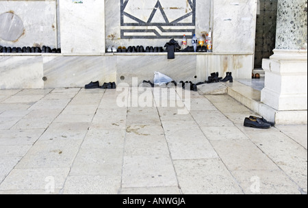 ISRAEL JERUSALEM Shoes left by Muslim pilgrims outside The Dome of the Rock - Stock Photo