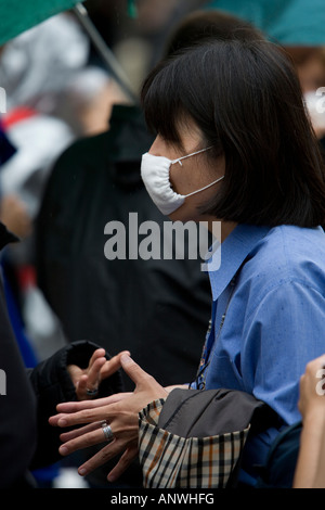 Japanese tourist wearing face mask Health Dublin Ireland - Stock Photo