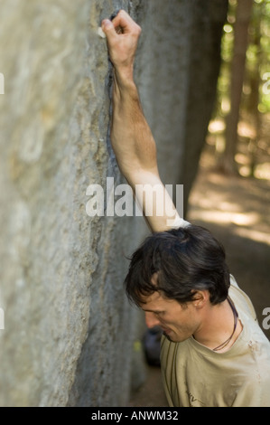 Closeup of a climber leading a route in the Elbe Sandstone Mountains Elbsandsteingebirge East Germany - Stock Photo