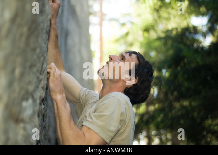 Closeup of a climber climbing a route in the Elbe Sandstone Mountains Elbsandsteingebirge East Germany - Stock Photo
