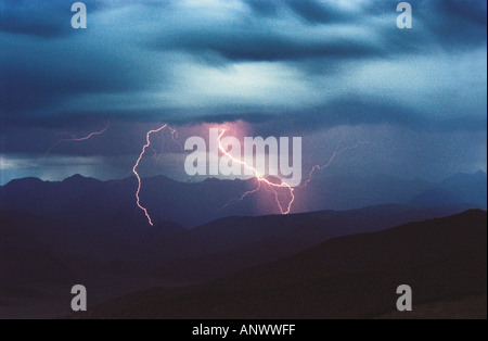 A flash of lightning over the Kuray Range. Altai. Siberia. Russia - Stock Photo