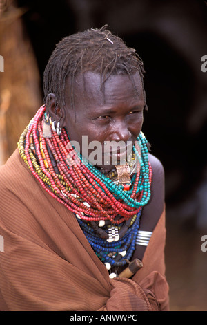 A Bume woman in her village in the Omo region of Ethiopia, Africa - Stock Photo