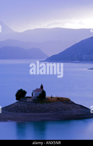 little church Saint Michel in middle of Serre Poncon lake, France, Alps - Stock Photo