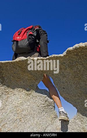 climber on rock near Calvi town, France, Corsica