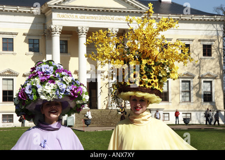 two women wearing flower hats in front of Woerlitz castle, Germany, Saxony-Anhalt - Stock Photo