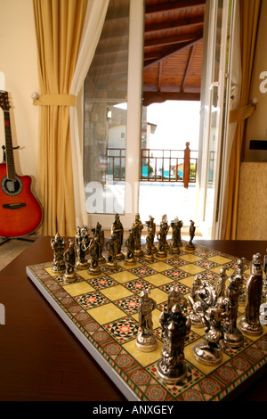 Exotic Chess Set With Guitar And View Through Window To Sun Patio In  Background   Stock