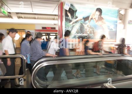 Asia, Thailand, Bangkok, Passengers in the Skytrain Station at Silom Center - Stock Photo