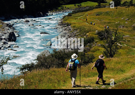 New Zealand, South Island, Mount Aspiring National Park. Hikers on the Rob Roy Glacier Hiking Track. - Stock Photo
