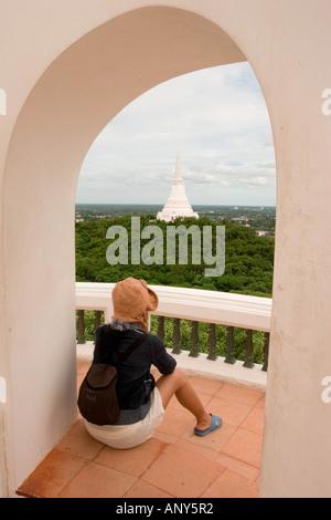 Thailand, Traveler looking at Phra That Chom Phet Chedi, part of Phra Nakon Khiri Palace - Stock Photo
