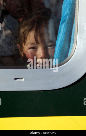 Girl passenger on board the Tangula Express / Sky Train, from Golmud, Qinghai province, China, to Lhasa, Tibet - Stock Photo
