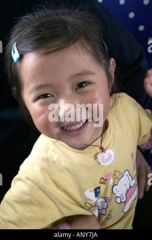 Tibetan girl passenger on the Qingzang/Qinghai-Xizang train, the world's highest railway, Tibet. - Stock Photo
