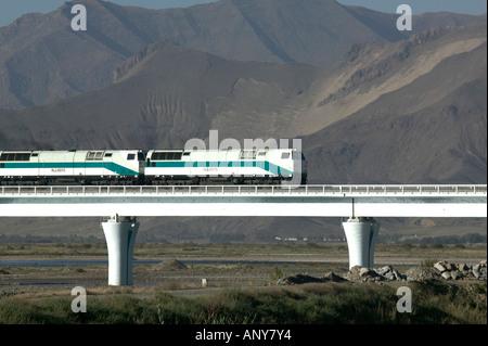 The Qingzang/Qinghai-Xizang train approaching Lhasa, Tibet - Stock Photo