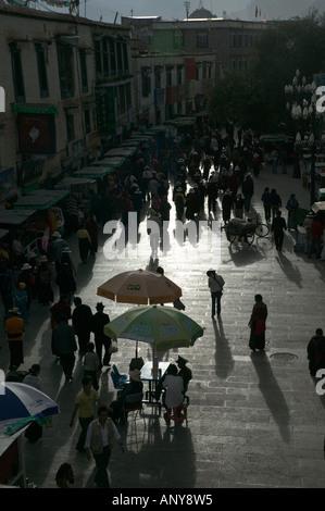 Pilgrims on the Barkhor Circuit before a rainstorm Lhasa Tibet China - Stock Photo