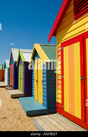 Colourful Wooden Beach Boxes - Stock Photo