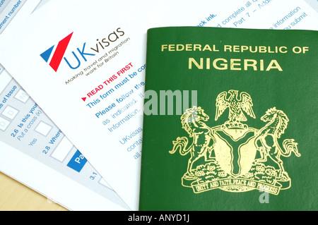 UK visa application form and Nigerian passport - Stock Photo