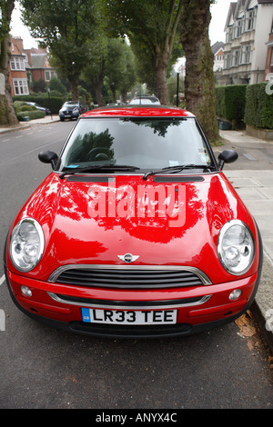 Red Mini One car parked in a parking bay in a London street England United Kingdom - Stock Photo
