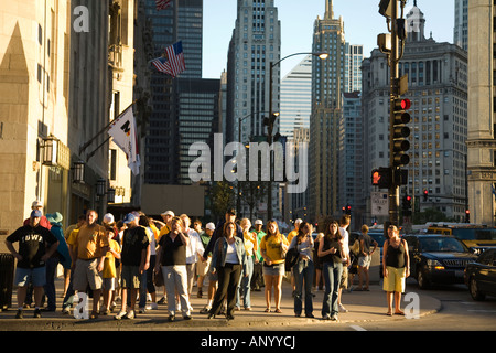 ILLINOIS Chicago Crowd of people on Michigan Avenue waiting for walk signal to cross street late summer afternoon - Stock Photo